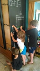 Spending time at our chalkboard playing with chalk and rulers.