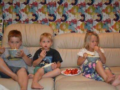 Yes the kids are eating on the couch, yes Melia is eating with her fingers with her eyes closed, Yes they are watching TV, that's how we roll . . .