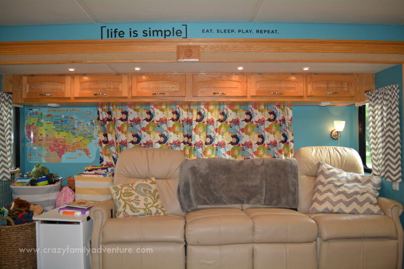 During the RV remodel, we removed some sections of the couch to make room for storage, painted the walls, and hung custom curtains