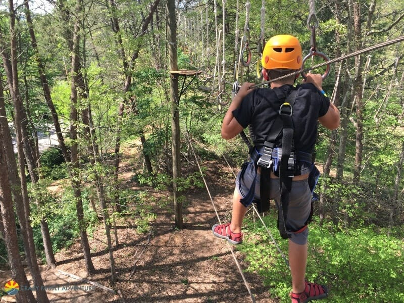 Carson navigating the ropes course in Asheville, NC
