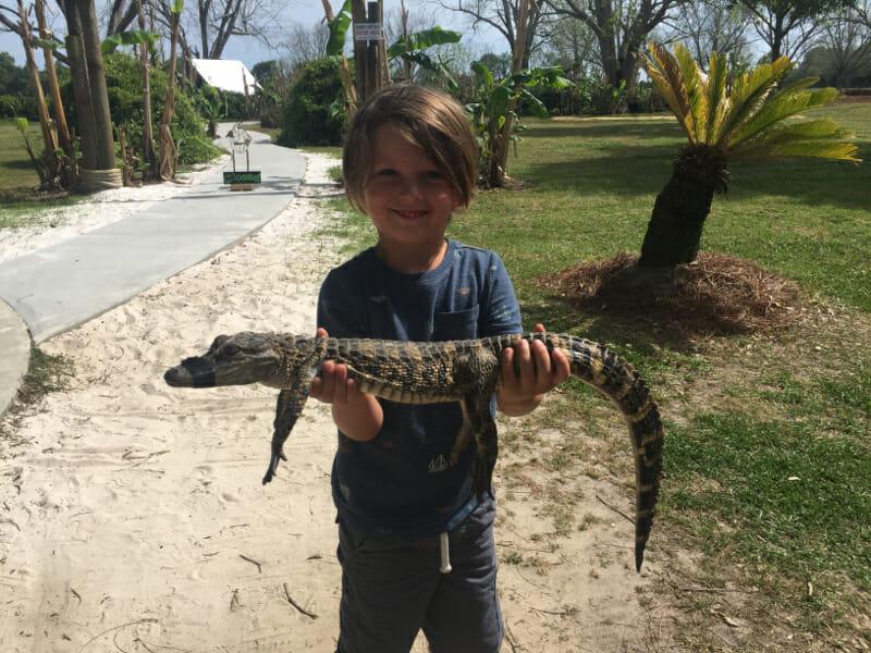 Knox holding an Alligator