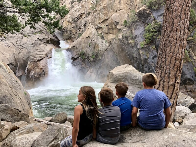 The kids are taking in the beauty of Roaring River Falls in King's Canyon National Park near Sequoia National Park