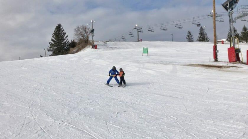 Getting ski lessons on Wilmot Mountain