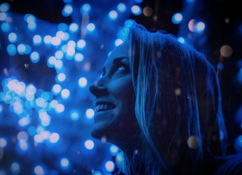 Woman looking at Christmas light in Wisconsin