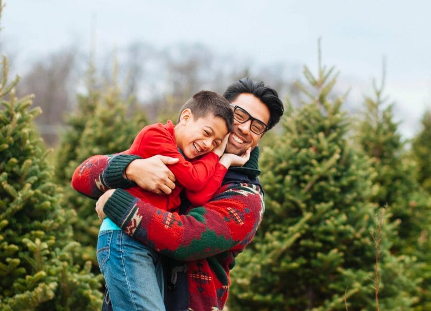 Dad and kid at Christmas tree far Wisconsin